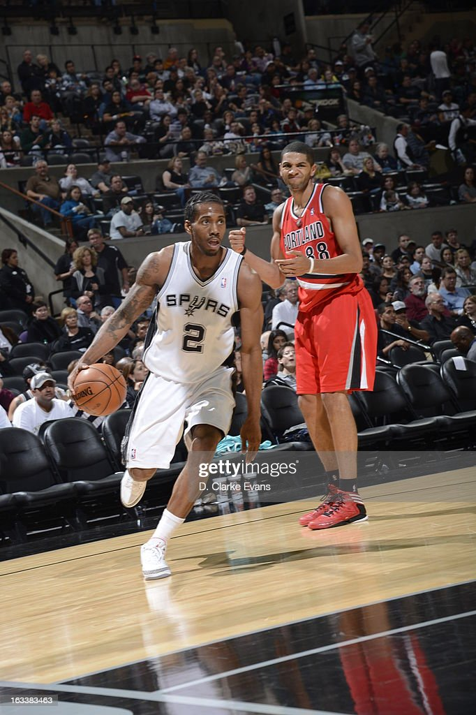 <a gi-track='captionPersonalityLinkClicked' href=/galleries/search?phrase=Kawhi+Leonard&family=editorial&specificpeople=6691012 ng-click='$event.stopPropagation()'>Kawhi Leonard</a> #2 of the San Antonio Spurs drives baseline against the Portland Trail Blazers on MARCH 8, 2013 at the AT&T Center in San Antonio, Texas.