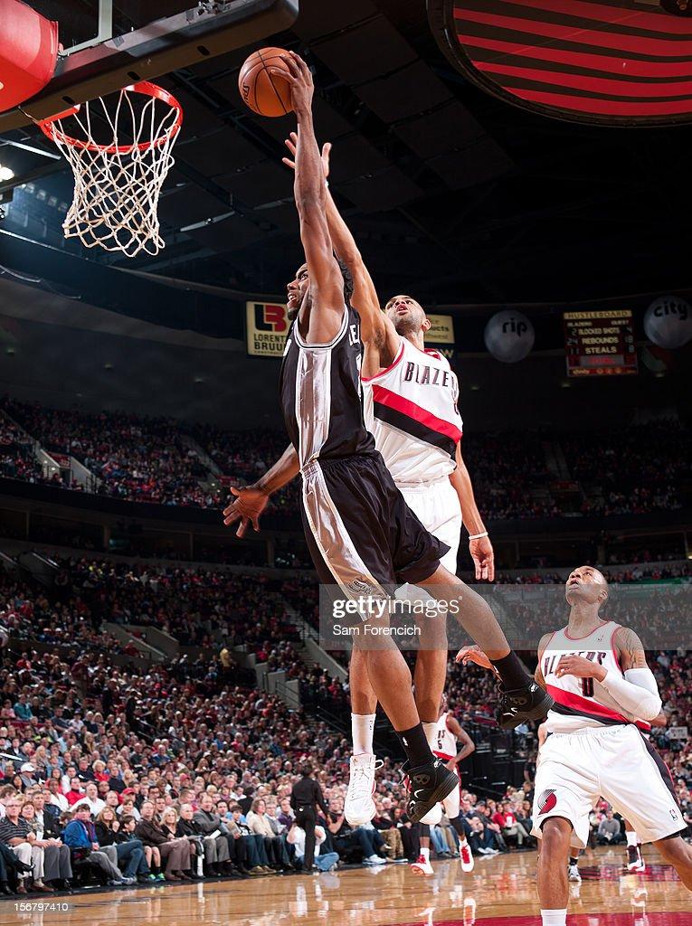 Kawhi Leonard #2 of the San Antonio Spurs drives to the basket against Nicolas Batum #88 of the Portland Trail Blazers on November 10, 2012 at the Rose Garden Arena in Portland, Oregon.