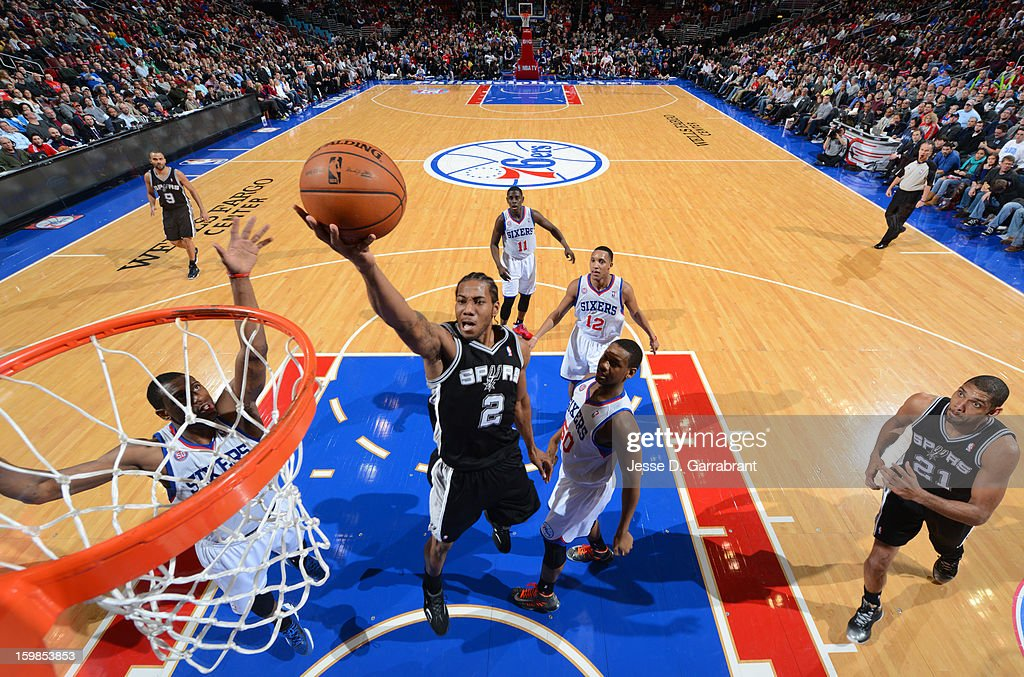 <a gi-track='captionPersonalityLinkClicked' href=/galleries/search?phrase=Kawhi+Leonard&family=editorial&specificpeople=6691012 ng-click='$event.stopPropagation()'>Kawhi Leonard</a> #2 of the San Antonio Spurs drives to the basket against the Philadelphia 76ers during the game at the Wells Fargo Center on January 21, 2013 in Philadelphia, Pennsylvania.