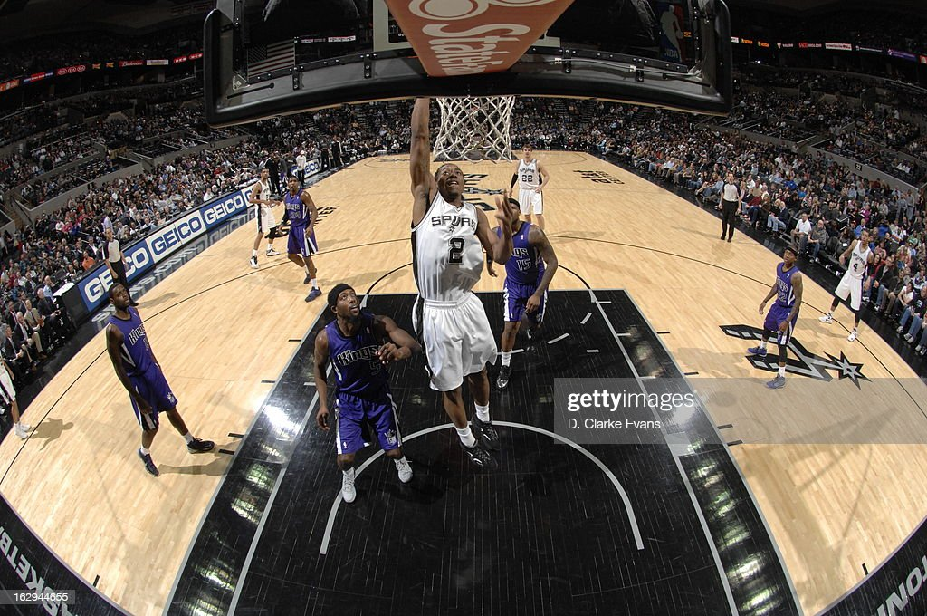 Kawhi Leonard #2 of the San Antonio Spurs drives to the basket against the Sacramento Kings on March 1, 2013 at the AT&T Center in San Antonio, Texas.