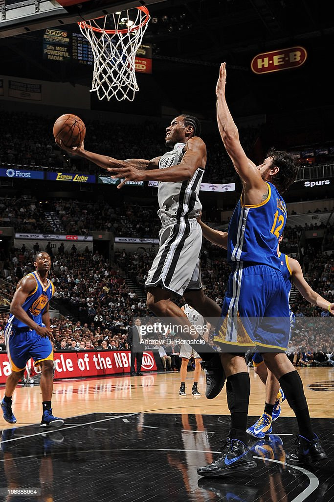 <a gi-track='captionPersonalityLinkClicked' href=/galleries/search?phrase=Kawhi+Leonard&family=editorial&specificpeople=6691012 ng-click='$event.stopPropagation()'>Kawhi Leonard</a> #2 of the San Antonio Spurs drives to the basket against <a gi-track='captionPersonalityLinkClicked' href=/galleries/search?phrase=Andrew+Bogut&family=editorial&specificpeople=207105 ng-click='$event.stopPropagation()'>Andrew Bogut</a> #12 of the Golden State Warriors in Game Two of the Western Conference Semifinals during the 2013 NBA Playoffs on May 8, 2013 at the AT&T Center in San Antonio, Texas.