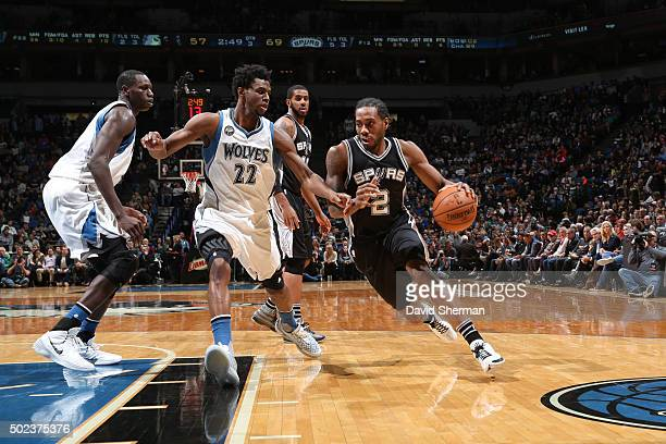 Kawhi Leonard of the San Antonio Spurs drives to the basket against the Minnesota Timberwolves during the game on December 23 2015 at Target Center...