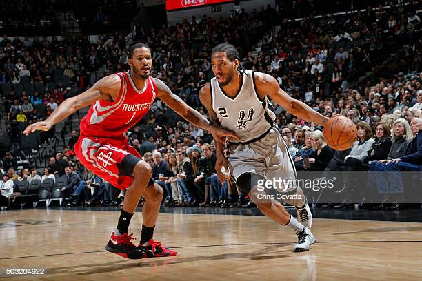 Kawhi Leonard of the San Antonio Spurs drives to the basket against the Houston Rockets during the game on January 2 2016 at ATT Center in San...