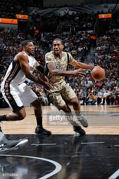 Kawhi Leonard of the San Antonio Spurs drives to the basket against the Miami Heat during the game on March 23 2016 at ATT Center in San Antonio...