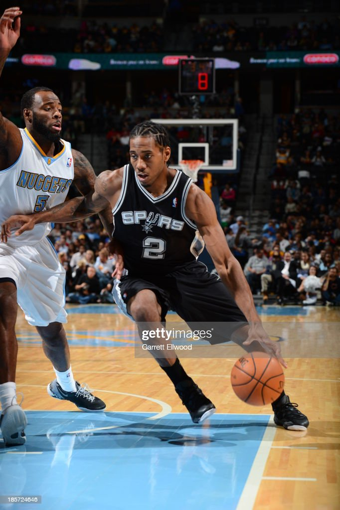 Kawhi Leonard #2 of the San Antonio Spurs drives to the basket during the game against the Denver Nuggets on October 14, 2013 at the Pepsi Center in Denver, Colorado.