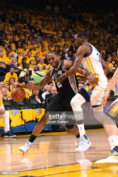 Kawhi Leonard of the San Antonio Spurs drives to the basket during the game against the Golden State Warriors during Game One of the Western...