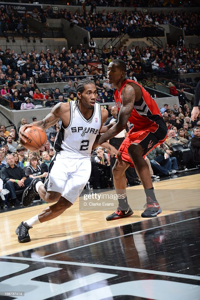 Kawhi Leonard #2 of the San Antonio Spurs drives under pressure during the game between the Toronto Raptors and the San Antonio Spurs on December 26, 2012 at the AT&T Center in San Antonio, Texas.