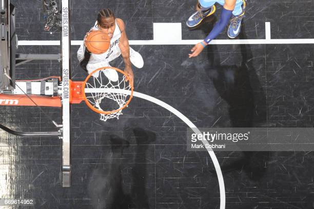 Kawhi Leonard of the San Antonio Spurs dunks against against the Memphis Grizzlies during Game Two of the Western Conference Quarterfinals of the...