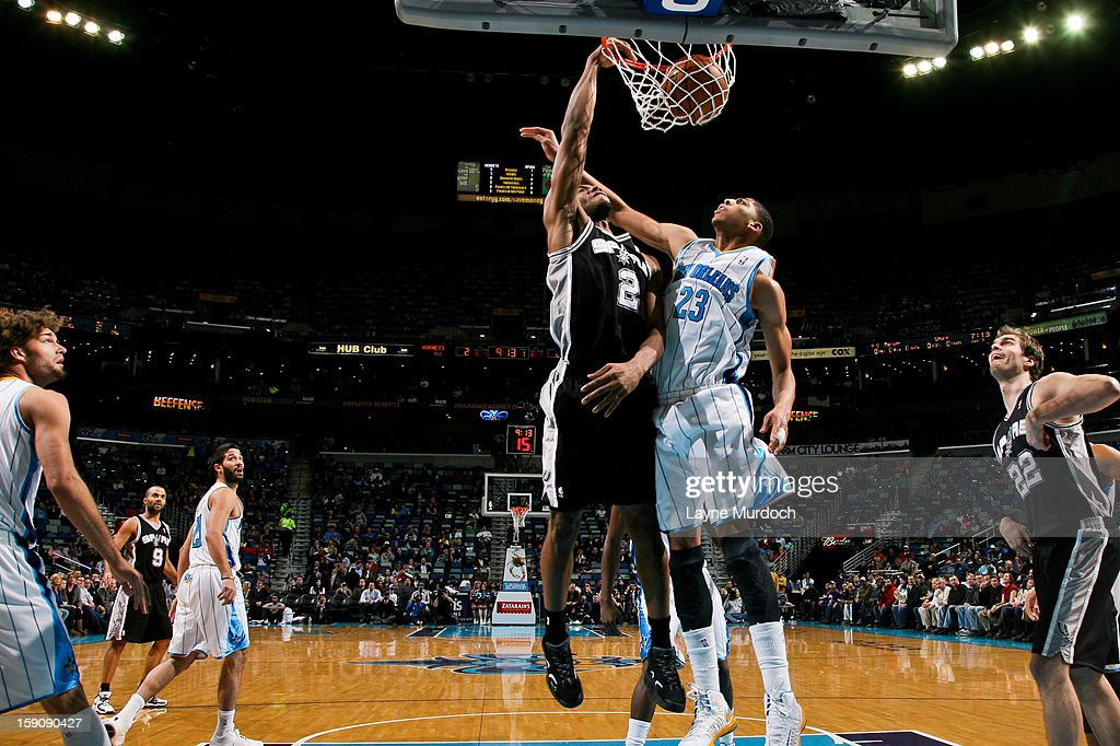 Kawhi Leonard #2 of the San Antonio Spurs dunks against Anthony Davis #23 of the New Orleans Hornets on January 7, 2013 at the New Orleans Arena in New Orleans, Louisiana.