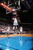 Kawhi Leonard of the San Antonio Spurs dunks against the Serge Ibaka of the Oklahoma City Thunder in Game Six of the Western Conference Finals during...