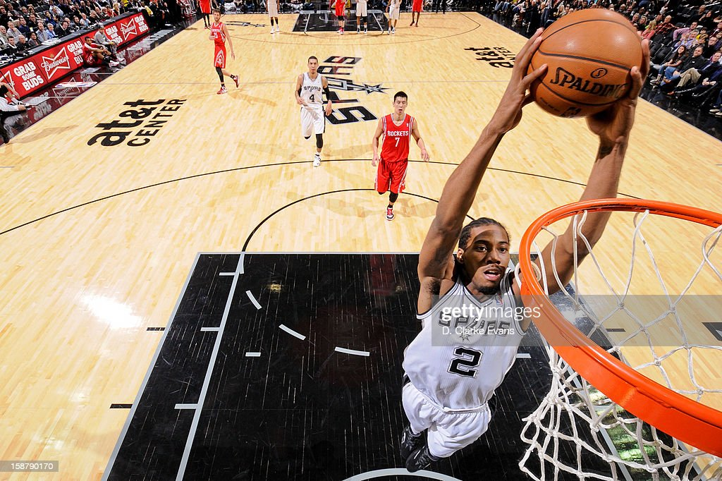 Kawhi Leonard #2 of the San Antonio Spurs dunks on a fast break against the Houston Rockets on December 28, 2012 at the AT&T Center in San Antonio, Texas.