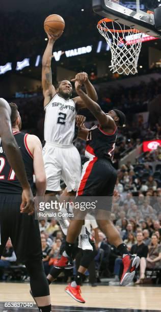 Kawhi Leonard of the San Antonio Spurs dunks over Noah Vonleh of the Portland Trail Blazers at ATT Center on March 15 2017 in San Antonio Texas NOTE...