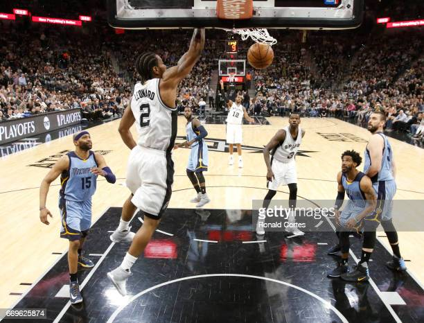 Kawhi Leonard of the San Antonio Spurs dunks over the Memphis Grizzlies in Game Two of the Western Conference Quarterfinals during the 2017 NBA...