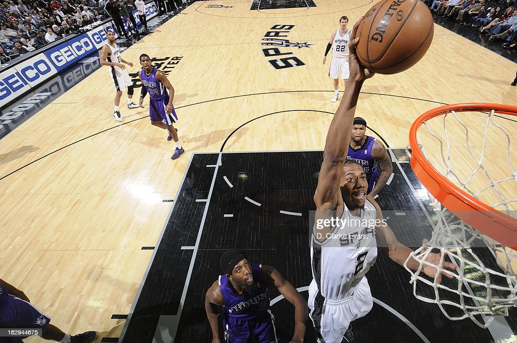 Kawhi Leonard #2 of the San Antonio Spurs dunks the ball against the Sacramento Kings on March 1, 2013 at the AT&T Center in San Antonio, Texas.