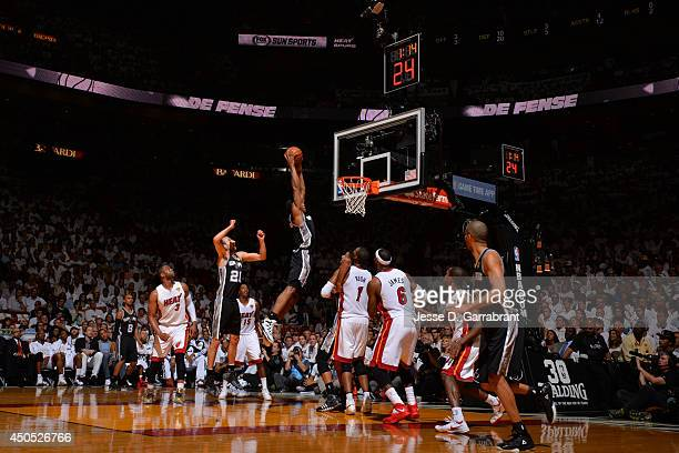 Kawhi Leonard of the San Antonio Spurs dunks the ball against the Miami Heat during Game Six of the 2014 NBA Finals on June 12 2014 at American...