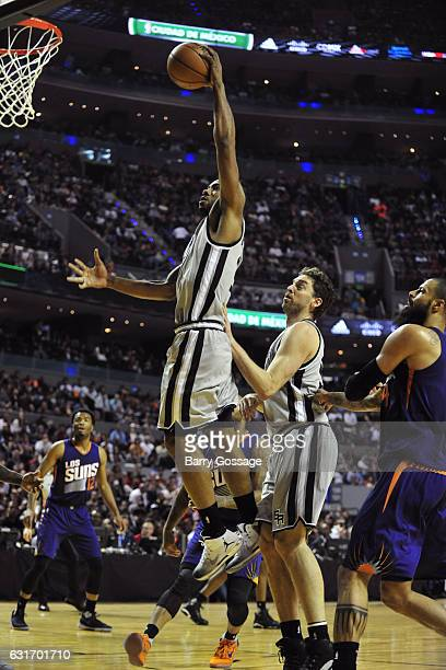 Kawhi Leonard of the San Antonio Spurs dunks the ball against the Phoenix Suns as part of NBA Global Games at Arena Ciudad de Mexico on January 14...