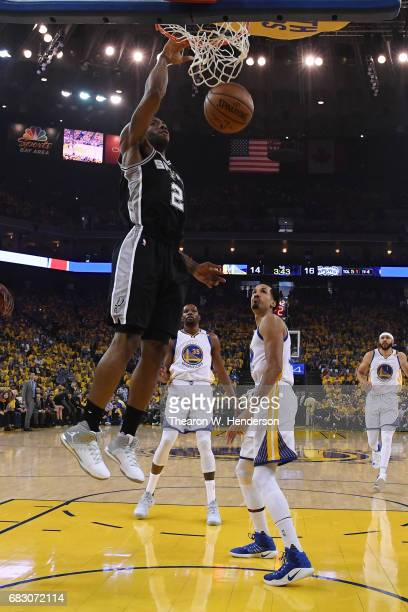 Kawhi Leonard of the San Antonio Spurs dunks the ball against the Golden State Warriors during Game One of the NBA Western Conference Finals at...