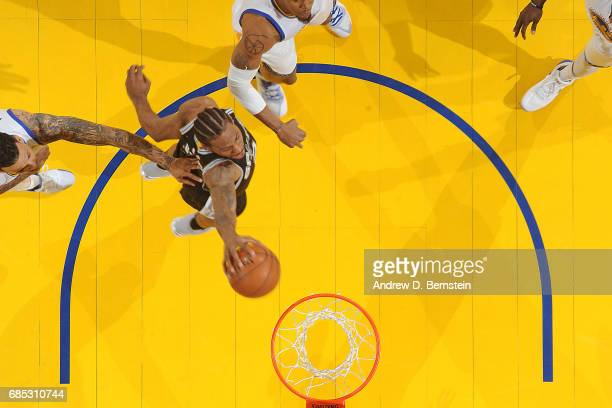 Kawhi Leonard of the San Antonio Spurs dunks the ball against the Golden State Warriors in Game One of the Western Conference Finals during the 2017...
