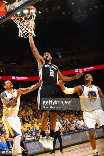 Kawhi Leonard of the San Antonio Spurs dunks the ball during the game against the Golden State Warriors during Game One of the Western Conference...