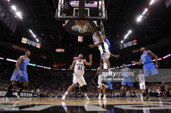 Kawhi Leonard of the San Antonio Spurs dunks the ball over Kendrick Perkins of the Oklahoma City Thunder in the first quarter n Game Two of the...