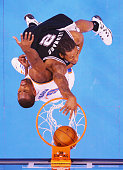 Kawhi Leonard of the San Antonio Spurs dunks the ball over Serge Ibaka of the Oklahoma City Thunder in the first half during Game Six of the Western...