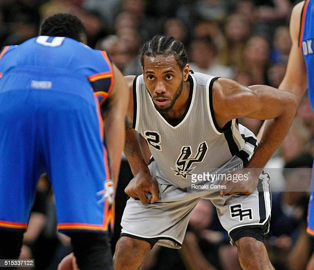 Kawhi Leonard of the San Antonio Spurs focus on defense against the Oklahoma City Thunder at ATT Center on March 12 2016 in San Antonio Texas NOTE TO...