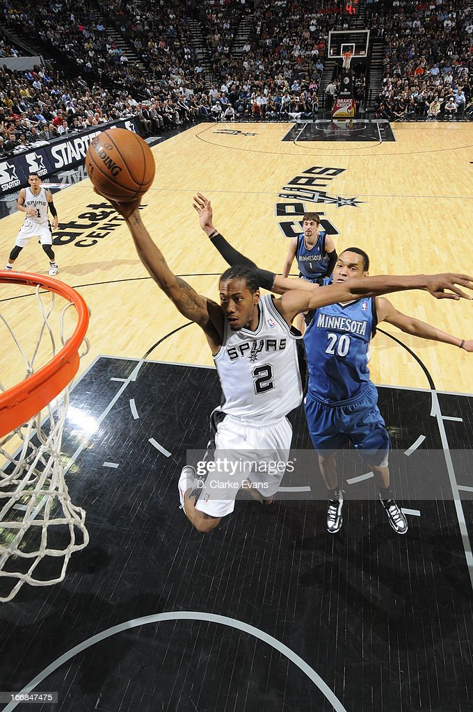 Kawhi Leonard #2 of the San Antonio Spurs glides to the rim against the Minnesota Timberwolves on April 17, 2013 at the AT&T Center in San Antonio, Texas.
