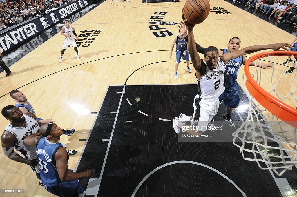 Kawhi Leonard #2 of the San Antonio Spurs glidse to the basket for the dunk against the Minnesota Timberwolves on April 17, 2013 at the AT&T Center in San Antonio, Texas.