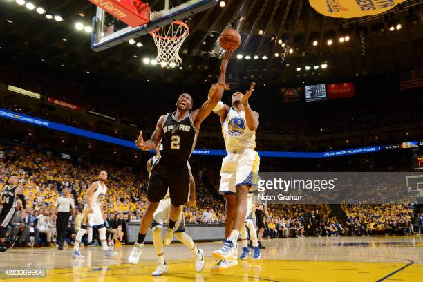 Kawhi Leonard of the San Antonio Spurs goes for a lay up during the game against David West of the Golden State Warriors during Game One of the...