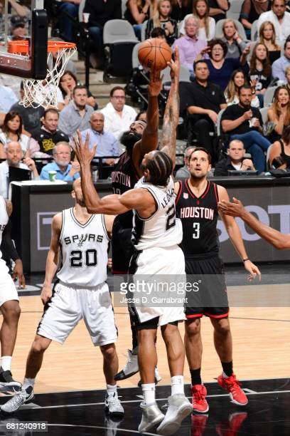 Kawhi Leonard of the San Antonio Spurs goes for a rebound against James Harden of the Houston Rockets during Game Five of the Western Conference...