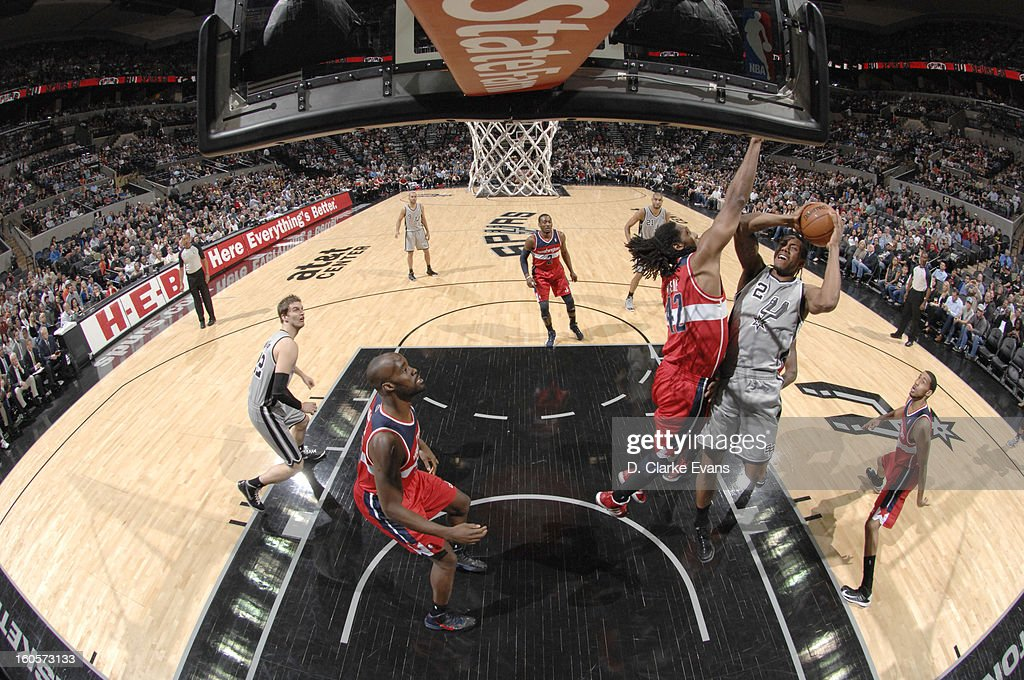 <a gi-track='captionPersonalityLinkClicked' href=/galleries/search?phrase=Kawhi+Leonard&family=editorial&specificpeople=6691012 ng-click='$event.stopPropagation()'>Kawhi Leonard</a> #2 of the San Antonio Spurs goes to the basket against Nene #42 of the Washington Wizards during the game between the Washington Wizards and the San Antonio Spurs on February 2, 2013 at the AT&T Center in San Antonio, Texas.