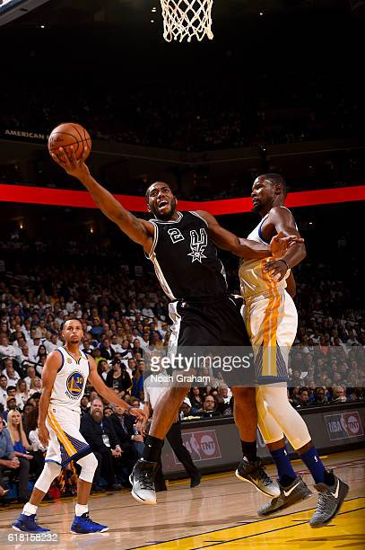 Kawhi Leonard of the San Antonio Spurs goes to the basket against the Golden State Warriors during a game on October 25 2016 at ORACLE Arena in...