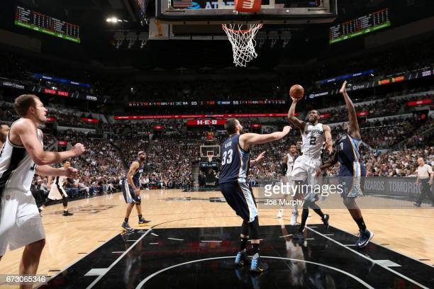Kawhi Leonard of the San Antonio Spurs goes to the basket against the Memphis Grizzlies during Game Five of the Western Conference Quarterfinals of...
