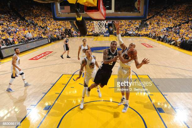 Kawhi Leonard of the San Antonio Spurs goes to the basket against the Golden State Warriors in Game One of the Western Conference Finals of the 2017...