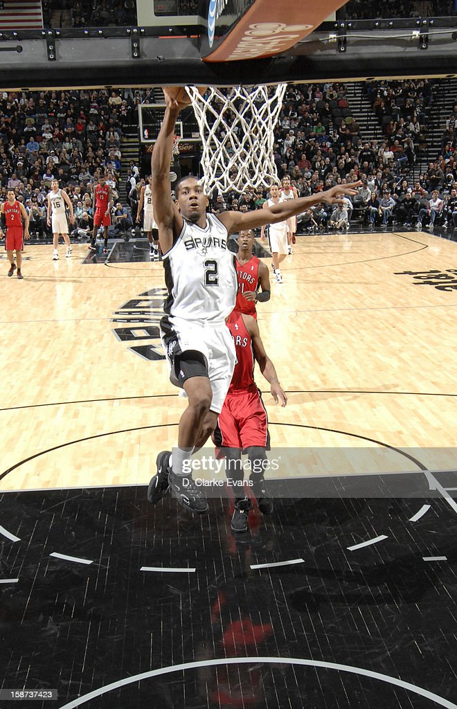 <a gi-track='captionPersonalityLinkClicked' href=/galleries/search?phrase=Kawhi+Leonard&family=editorial&specificpeople=6691012 ng-click='$event.stopPropagation()'>Kawhi Leonard</a> #2 of the San Antonio Spurs goes to the basket during the game between the Toronto Raptors and the San Antonio Spurs on December 26, 2012 at the AT&T Center in San Antonio, Texas.
