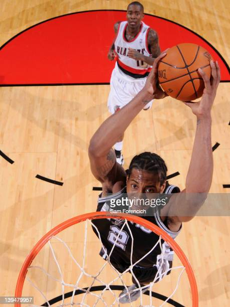 Kawhi Leonard of the San Antonio Spurs goes to the basket for a dunk during the game against the Portland Trail Blazers on February 21 2012 at the...