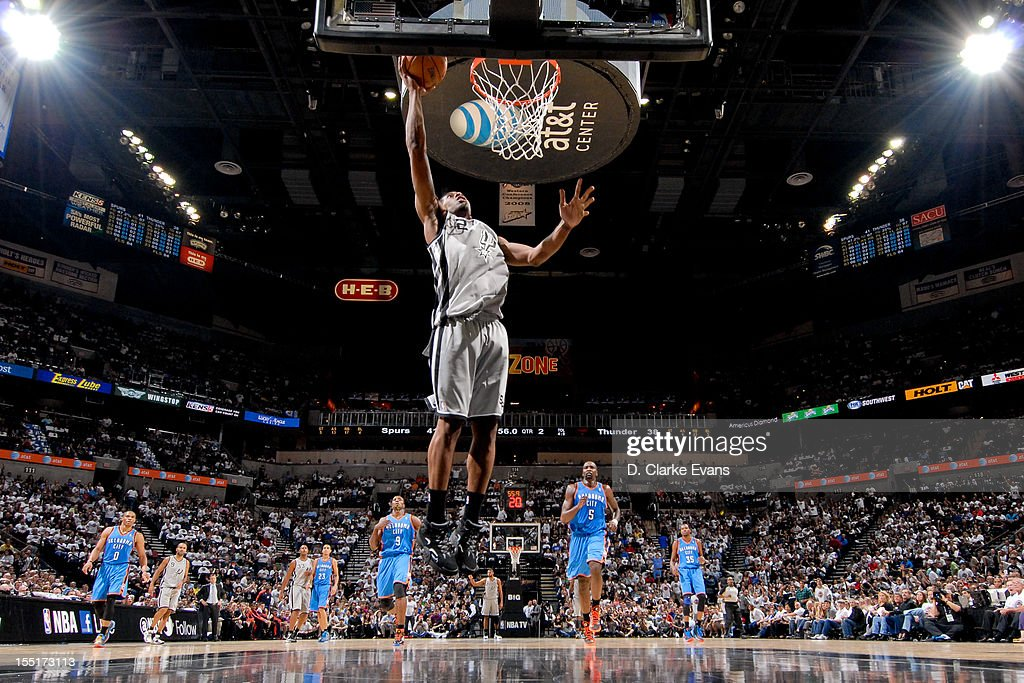 <a gi-track='captionPersonalityLinkClicked' href=/galleries/search?phrase=Kawhi+Leonard&family=editorial&specificpeople=6691012 ng-click='$event.stopPropagation()'>Kawhi Leonard</a> #2 of the San Antonio Spurs goes to the basket on a fast-break against the Oklahoma City Thunder on November 1, 2012 at the AT&T Center in San Antonio, Texas.