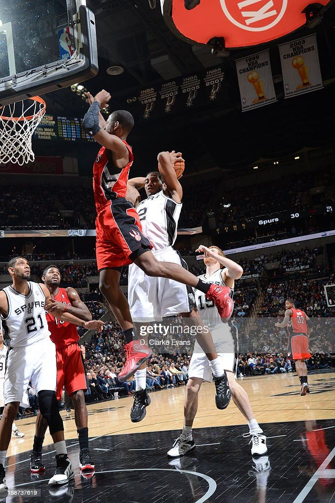 <a gi-track='captionPersonalityLinkClicked' href=/galleries/search?phrase=Kawhi+Leonard&family=editorial&specificpeople=6691012 ng-click='$event.stopPropagation()'>Kawhi Leonard</a> #2 of the San Antonio Spurs goes to the basket over defense during the game between the Toronto Raptors and the San Antonio Spurs on December 26, 2012 at the AT&T Center in San Antonio, Texas.