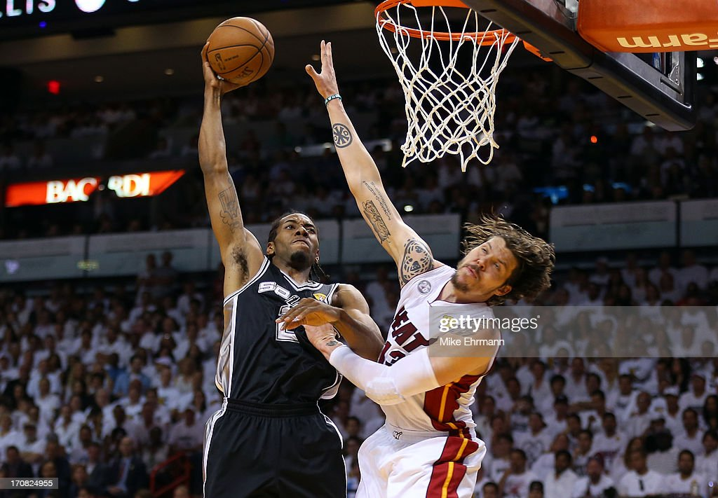 Kawhi Leonard #2 of the San Antonio Spurs goes up for a dunk over Mike Miller #13 of the Miami Heat in the first quarter of Game Six of the 2013 NBA Finals at AmericanAirlines Arena on June 18, 2013 in Miami, Florida.