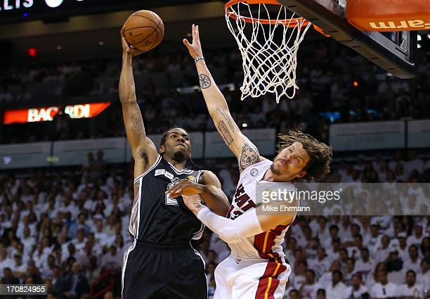 Kawhi Leonard of the San Antonio Spurs goes up for a dunk over Mike Miller of the Miami Heat in the first quarter of Game Six of the 2013 NBA Finals...