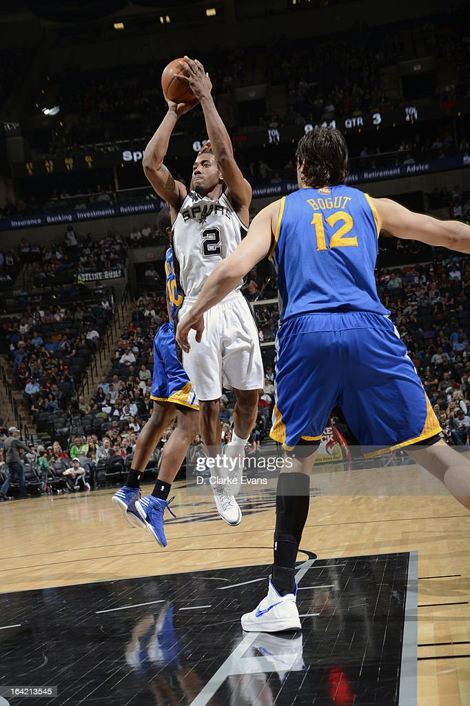Kawhi Leonard #2 of the San Antonio Spurs goes up for a jumper against Andrew Bogut #12 of the Golden State Warriors on March 20, 2013 at the AT&T Center in San Antonio, Texas.