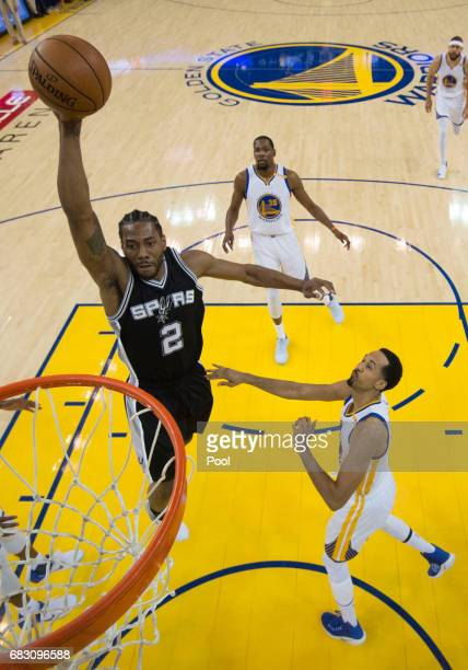 Kawhi Leonard of the San Antonio Spurs goes up for a shot against the Golden State Warriors during Game One of the NBA Western Conference Finals at...
