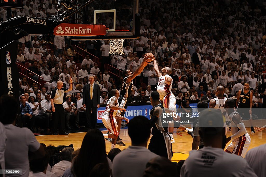 Kawhi Leonard #2 of the San Antonio Spurs grabs a rebound against Chris Bosh #1 of the Miami Heat during Game Six of the 2013 NBA Finals on June 18, 2013 at American Airlines Arena in Miami, Florida.