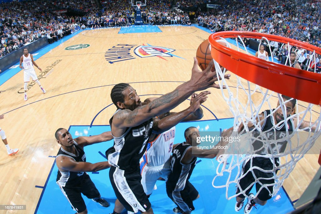 <a gi-track='captionPersonalityLinkClicked' href=/galleries/search?phrase=Kawhi+Leonard&family=editorial&specificpeople=6691012 ng-click='$event.stopPropagation()'>Kawhi Leonard</a> #2 of the San Antonio Spurs grabs a rebound against the Oklahoma City Thunder on April 4, 2013 at the Chesapeake Energy Arena in Oklahoma City, Oklahoma.