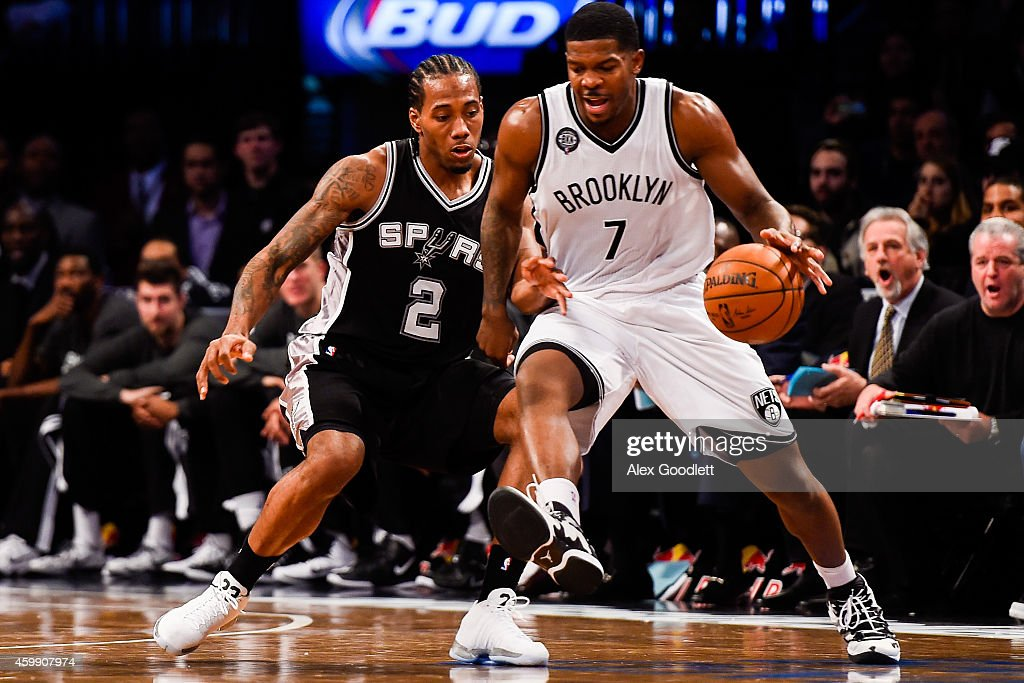 <a gi-track='captionPersonalityLinkClicked' href=/galleries/search?phrase=Kawhi+Leonard&family=editorial&specificpeople=6691012 ng-click='$event.stopPropagation()'>Kawhi Leonard</a> #2 of the San Antonio Spurs guards <a gi-track='captionPersonalityLinkClicked' href=/galleries/search?phrase=Joe+Johnson+-+Basketball+Player&family=editorial&specificpeople=201652 ng-click='$event.stopPropagation()'>Joe Johnson</a> #7 of the Brooklyn Nets at the Barclays Center on December 3, 2014 in the Brooklyn borough of New York City.