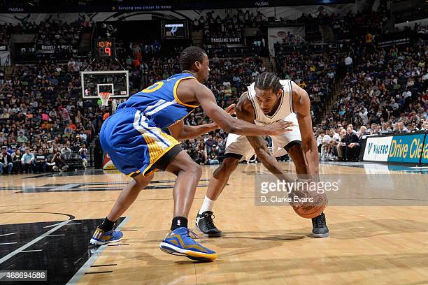 Kawhi Leonard of the San Antonio Spurs handles the ball against Harrison Barnes of the Golden State Warriors on April 5 2015 at the ATT Center in San...