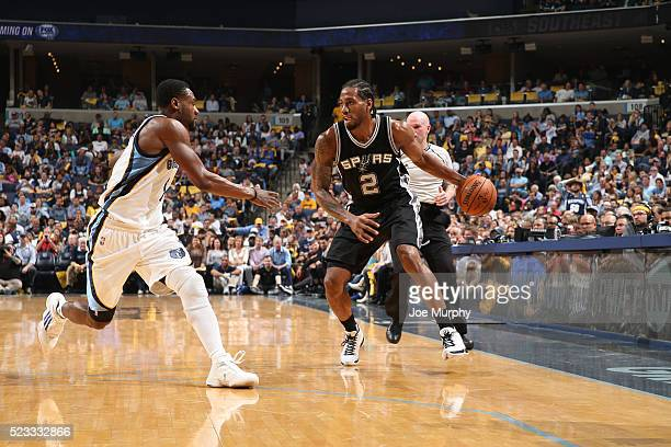Kawhi Leonard of the San Antonio Spurs handles the ball against the Memphis Grizzlies in Game Three of the Western Conference Quarterfinals of the...