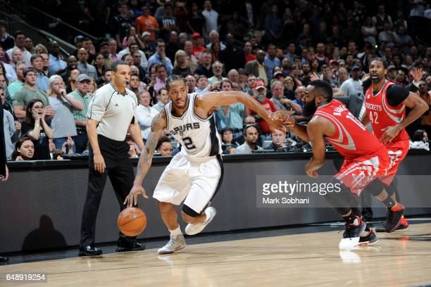 Kawhi Leonard of the San Antonio Spurs handles the ball against the Houston Rockets on March 6 2017 at the ATT Center in San Antonio Texas NOTE TO...