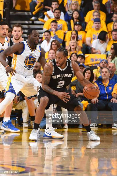 Kawhi Leonard of the San Antonio Spurs handles the ball against the Golden State Warriors in Game One of the Western Conference Finals of the 2017...