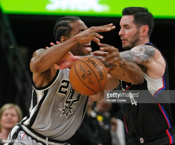 Kawhi Leonard of the San Antonio Spurs is stripped of the ball by JJ Redick of the Los Angeles Clippers at ATT Center on April 8 2017 in San Antonio...